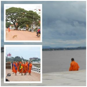 Orange cladded boys along the Mekong River